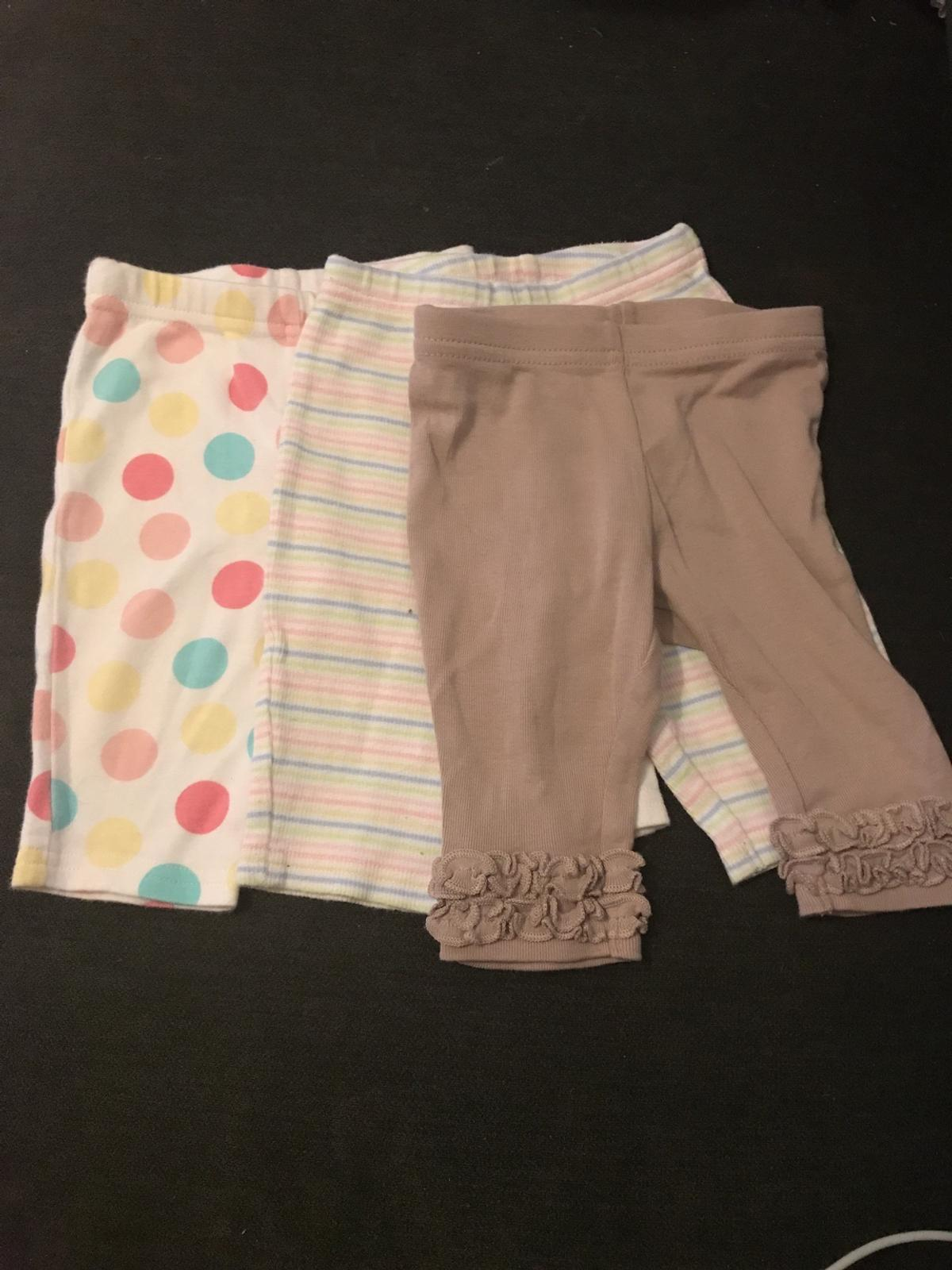 3 lovely pairs of leggings from Next baby, up to 3 months, 100% cotton.  Postage cost based on Royal Mail signed for second class delivery service.