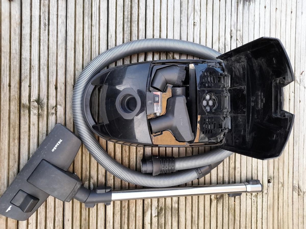 This hoover is used and still works well comes with attachments and new bags.