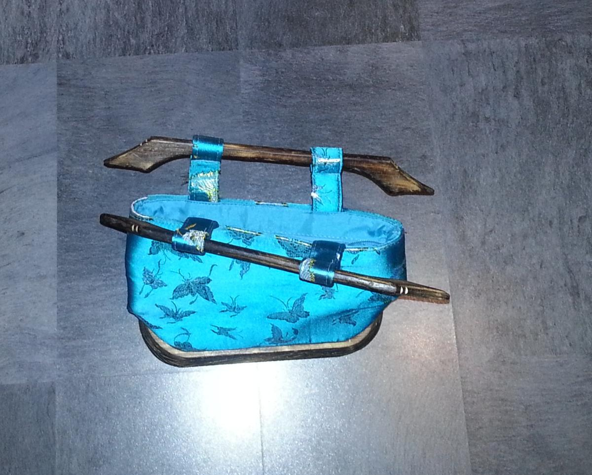 Turquoise satin material handbag with wooden handles, unique design, great condition, just not used anymore.