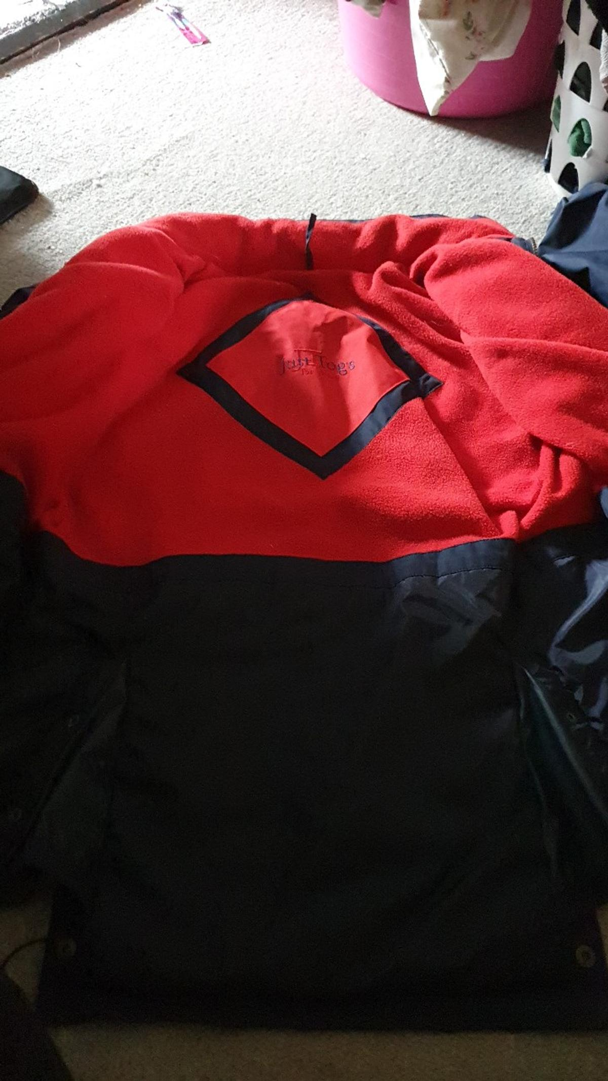 just togs riders jacket with hood. medium. New condition barely ever worn as was too big.