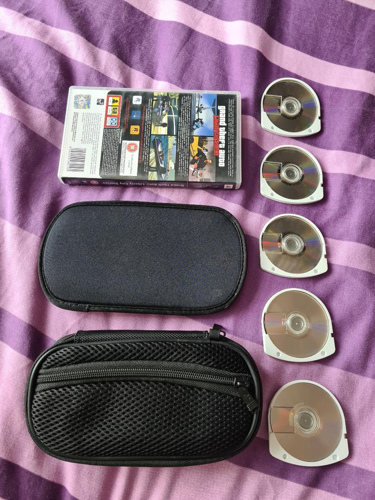 5x PSP games + 2x official cases Includes: GTA: liberty City stories, Star Wars: battlefront 2, Spiderman 2, Fifa 08, Pro evolution soccer 2008 + 2x official cases (PAL) Game UMD's only except GTA that comes w/ box In good condition, tested & working Everything as seen in pics From a pet & smoke free home Collection S63 P&P available (can also do combined) Check out my other items for sale Any questions please ask