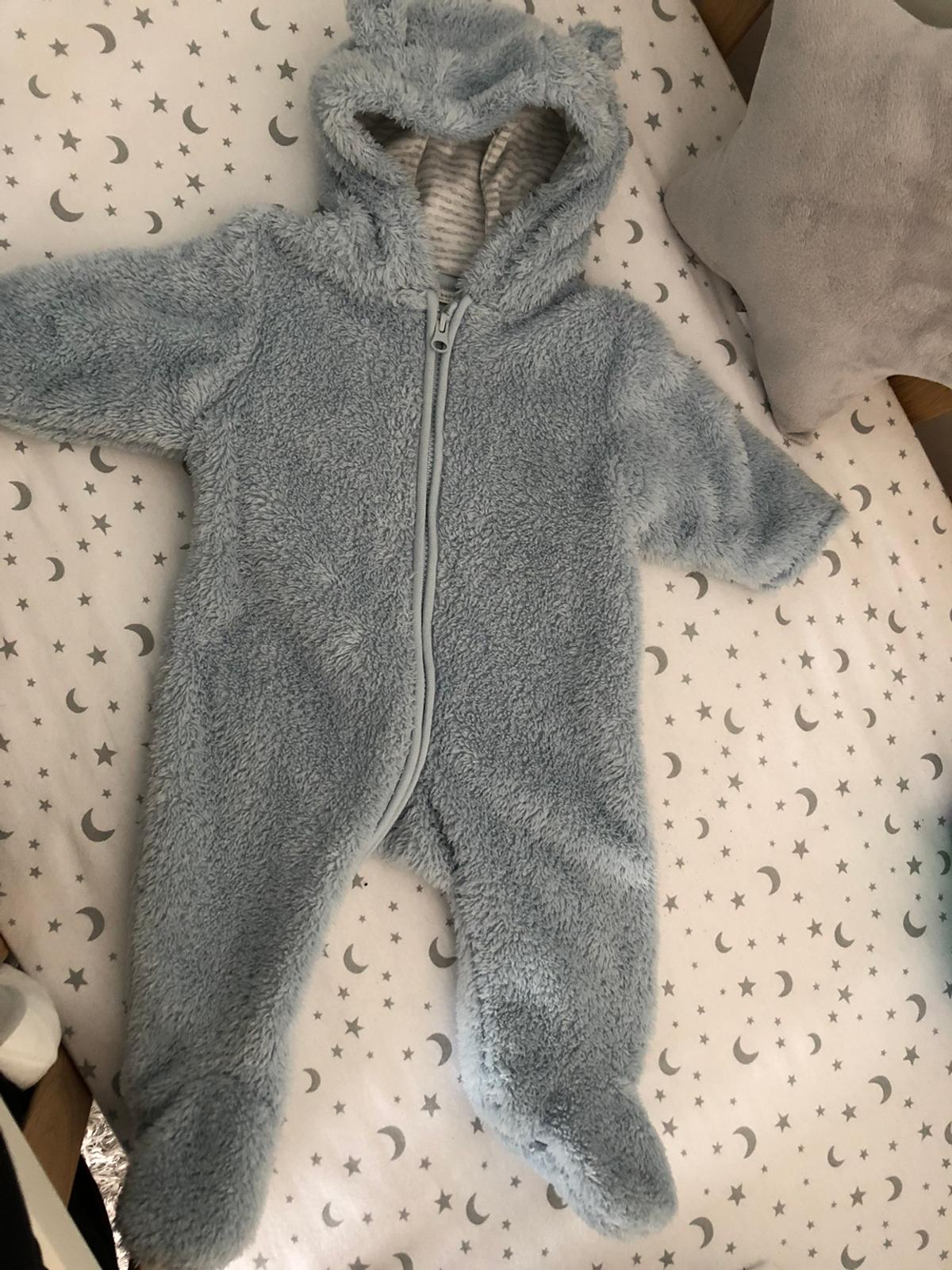 3-6 months, next baby blue fluffy pram suit. Excellent condition. Pet smoke free home.