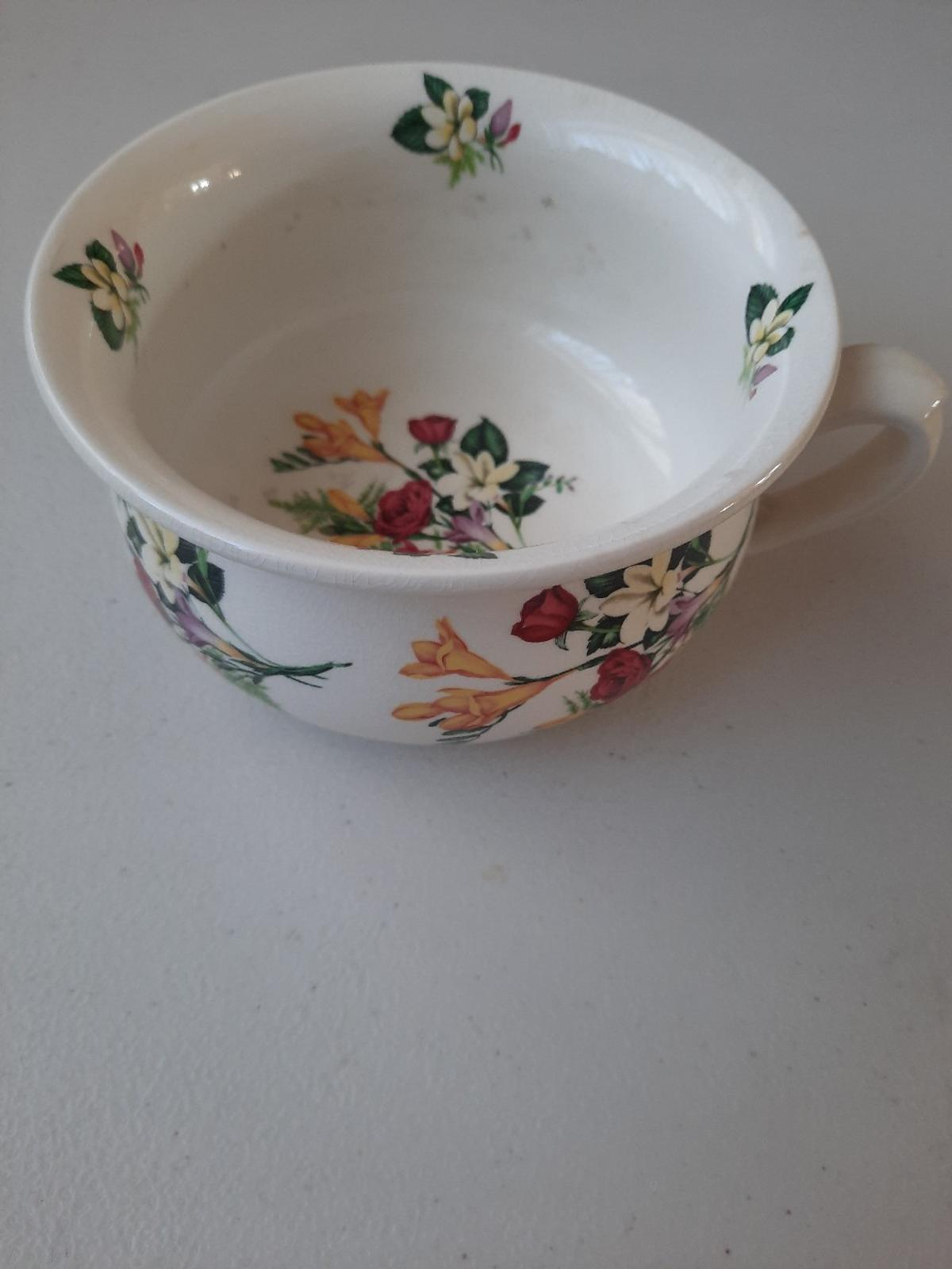 Chamber pot 25cm diameter. Slight crazing to glaze but overall in good condition