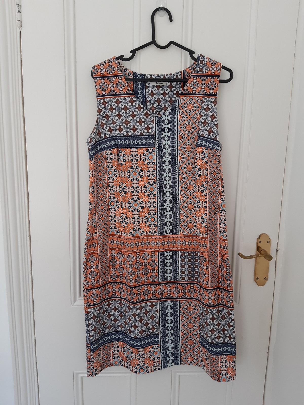 Tu dress, thick stretch material. Fitted shape size 12. Only worn once.