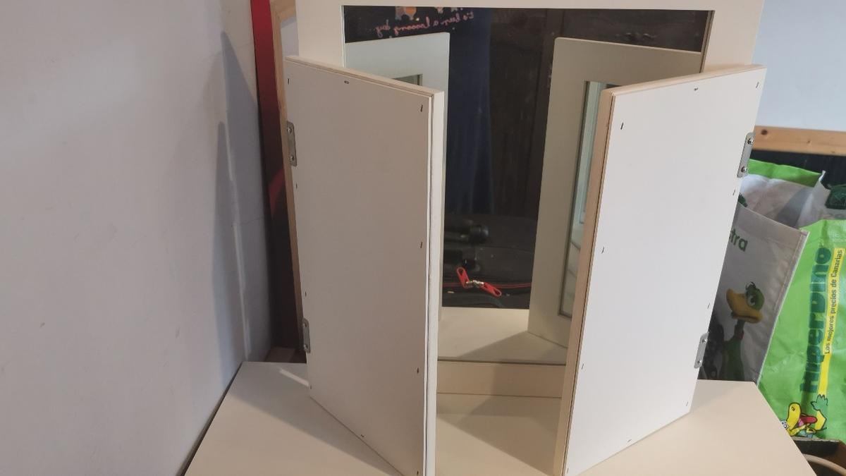 Mirror for dressing table are on top of a chest of drawers