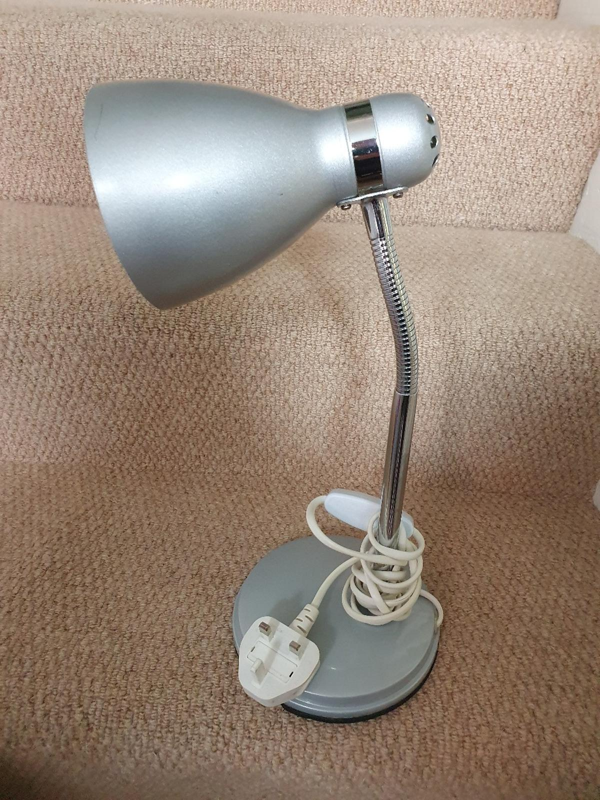 Silver desk lamp in good working order.